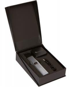 The Kind Pen Weezy portable vape kit in box with battery, mouthpiece, charger, and glass concentrate container.